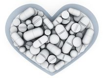 Many tablets and vitamin in shape heart Royalty Free Stock Photography