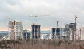 Many tall buildings and cranes Stock Photo