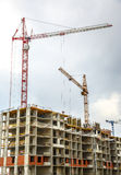 Many tall buildings and cranes Royalty Free Stock Photo