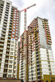 Many tall buildings and cranes Stock Image