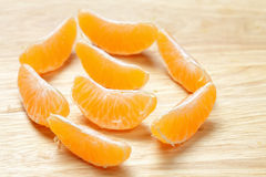Many tangerine slices Stock Photos