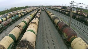Many tank-trains on railway tracks stock footage