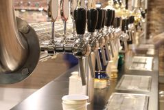 Taps of the brewery to spice fresh beer to quench the customers Royalty Free Stock Photos