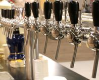 Taps to fill mugs of beer in the pub Stock Photography