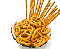 Many tasty salted pretzels and breadsticks. Tasty salted pretzels and breadsticks closeup on white Stock Photo