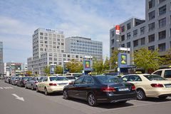 Many taxi cars in different colors waiting for passangers in front of Mannheim main station royalty free stock images