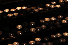 Many Tea Light Candles. Some Tea Light Candles on dark background Royalty Free Stock Photos
