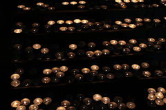 Many Tea Light Candles. Some Tea Light Candles on dark background Stock Photography