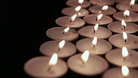 Many tea lights fluttering in the breeze and going out stock video
