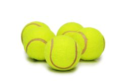Many tennis balls isolated. On the white Stock Images