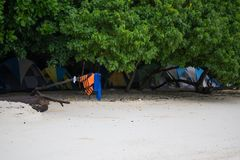 Tent set on sand beach for staying overnight and with tree cover. Many tent set on sand beach for staying overnight and with tree cover for protection sunlight Stock Photo
