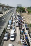 Many thai people line up at outdoor on the road for walking go to Bang pai temple Royalty Free Stock Photos