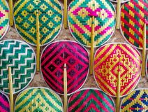 Many Thai style colorful wooden handmade fan arrange on the wall stock image