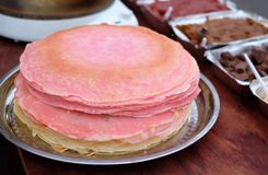 Many thin pancakes with crispy crust are stacked for breakfast and Shrovetide Maslenitsa.  stock photo