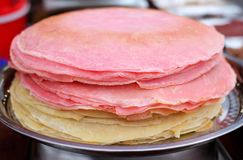 Many thin pancakes with crispy crust are stacked for breakfast and Shrovetide Maslenitsa.  stock image