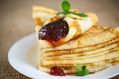Many thin pancakes with jam Royalty Free Stock Photo