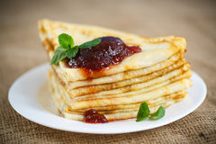 Many thin pancakes with jam Royalty Free Stock Photography