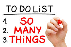 So Many Things To Do List. Hand writing So Many Things in To Do List with red marker isolated on white Royalty Free Stock Photo