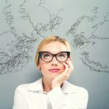 Many Thoughts with business woman. On a gray background Royalty Free Stock Image