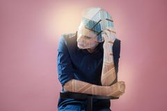 Nice young man touching his head. So many thoughts. Nice handsome young man leaning on the chair and touching his head while having many thoughts on his mind Royalty Free Stock Photography
