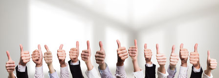Many thumbs of business people showing consent Stock Images