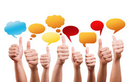 Many thumbs up with speech bubbles stock images