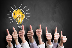 Many thumbs up to an idea Stock Photos