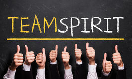 Many thumbs up to 'Team spirit' stock image