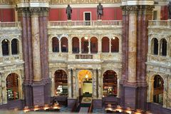 Classic arcade and columns of reading room. The many tiers of the Library of Congress reading room is a testament to Roman architecture. The arcade and Royalty Free Stock Image