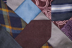 Many ties of various colors, which intertwined Stock Photography