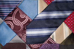 Many ties of various colors, which intertwined Stock Photos