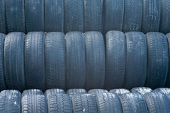 Many tires. Stack of old car tires royalty free stock photo