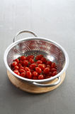 Many tomato in metal bowl Stock Photography