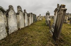Many tombstones in a row. On an old cemetery Royalty Free Stock Photography