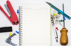 Many tools and blank note. For writer Royalty Free Stock Photos
