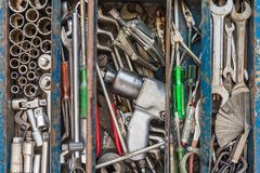 Many tools in rustic compartments toolbox. Technical machanic to. Olset for car automobile, motorcycle repair or DIY Stock Photography