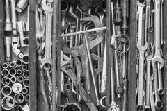 Many tools in rustic compartments toolbox. Technical machanic to. Olset for car automobile, motorcycle repair or DIY. - Black and white tone Royalty Free Stock Photography