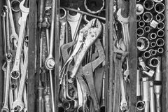 Many tools in rustic compartments toolbox. Technical machanic to. Olset for car automobile, motorcycle repair or DIY. - Black and white tone Stock Photos