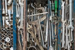 Many tools in rustic compartments toolbox. Technical machanic to. Olset for car automobile, motorcycle repair or DIY Stock Photos