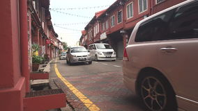 Many tourist car drive trough famous red historic building in Malacca. stock footage