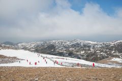 Many tourist playing snow in Valley of the Blue Moon in Shangri- Royalty Free Stock Photo