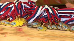 Medals await the awarding stock video footage