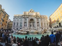 Many tourists around the Fontana Di Trevi fountain at the Piazza stock images