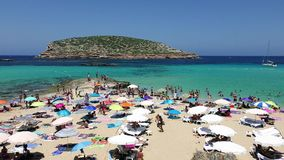 Many tourists at Cala Conta beach in Ibiza, 4k video stock video