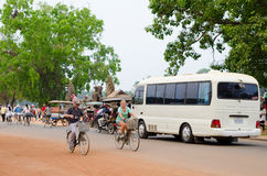 Many tourists on different transports at Angkor, Cambodia Stock Photos
