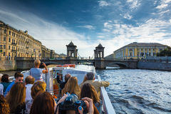 Many tourists enjoy boat trips in St. Petersburg. ST PETERSBURG, RUSSIA - JULY 14, 2016: Many tourists enjoy boat trips in St. Petersburg, Russia Stock Photo