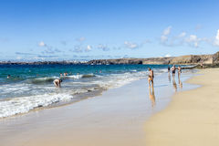 Many tourists enjoy Papagayo beach on a sunny  day Royalty Free Stock Image