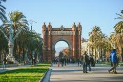 Many tourists near the Arc de Triomphe, Barcelona, Spain Stock Photos
