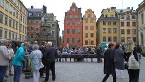 Many tourists on the square in front of the Nobel Museum in the old town Gamla Stan in Stockholm. STOCKHOLM, SWEDEN - JUNE 20, 2018: Many tourists on the square stock footage