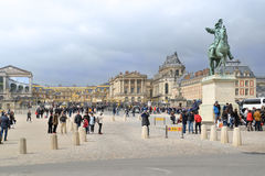 Many tourists at Versailles Palace, France. Versailles, France - March 31, 2015: Many tourists come to visits Versailles Palace even though it is about to rain stock image